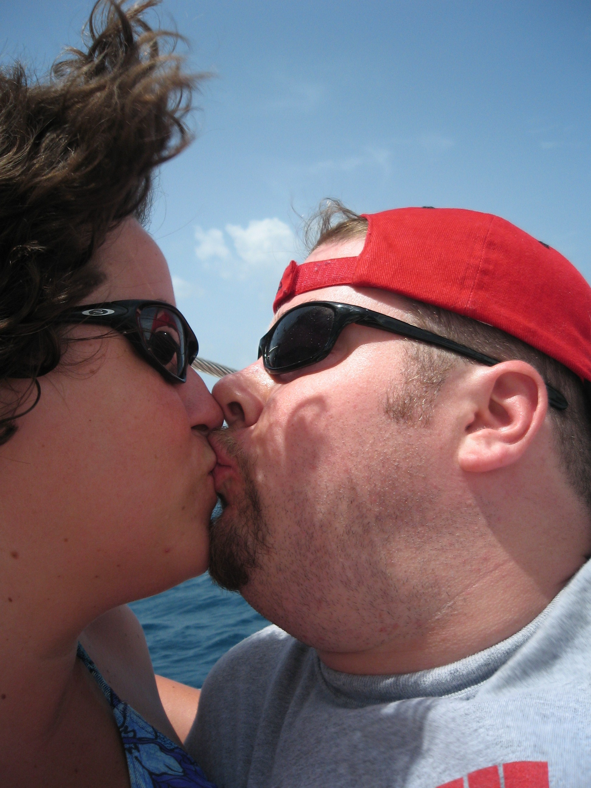 BJ and Katie kiss on the Catamaran