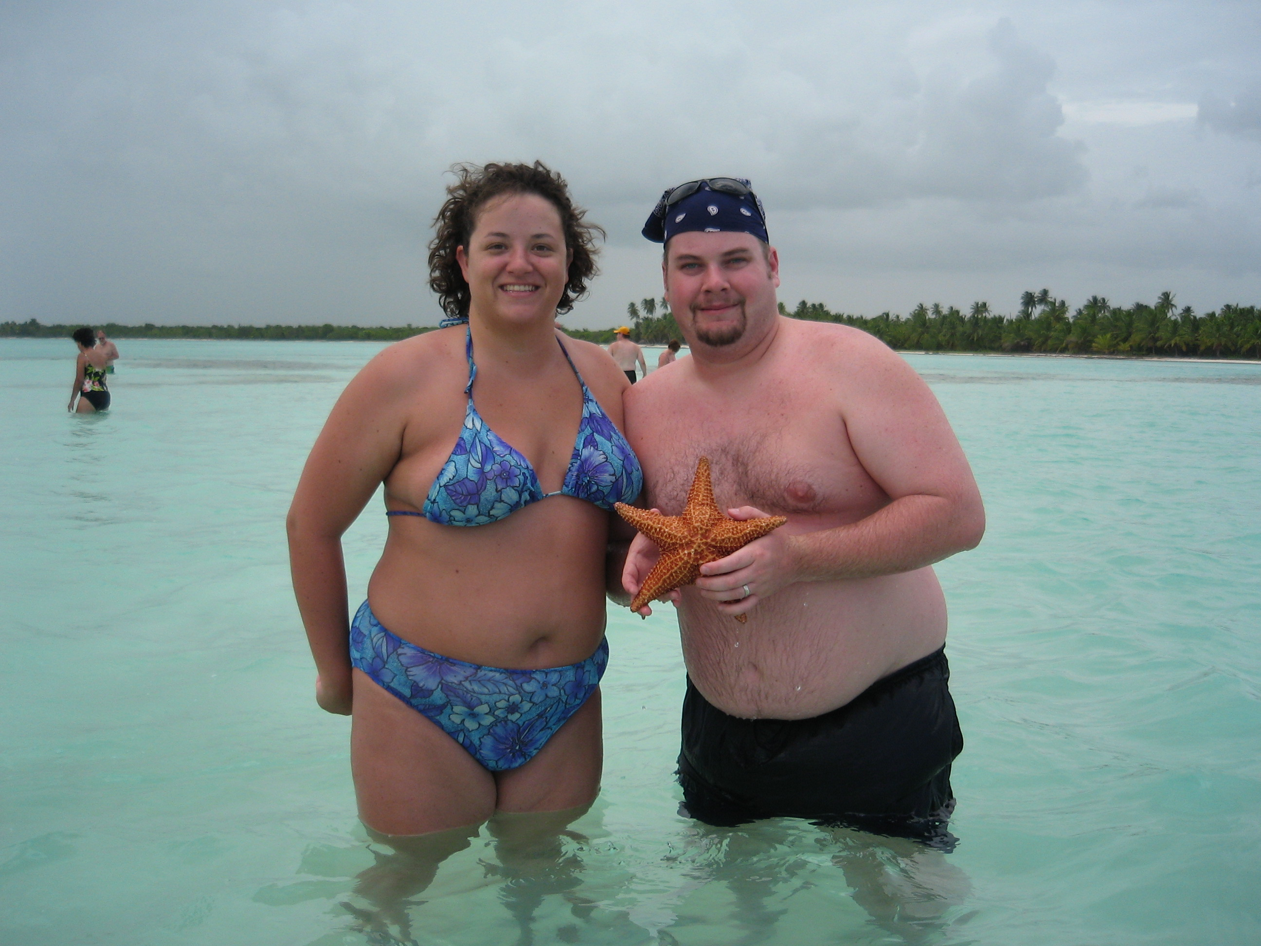 BJ and Katie with a starfish in the natural swimming pool